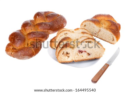 Home-baked rolls of bread made �¢??�¢??from wheat and seeds. Sliced �¢??�¢??pieces on a plate.