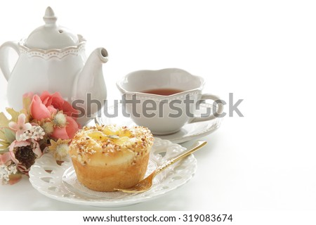 Home bakery, apple and cinnamon bun with English tea