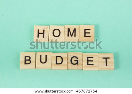 Home budget words phrase. Tax, finances, family, home and happiness concept Counting losses and profit analyzing financial statistics, green money background with copy space for ad text. - stock photo