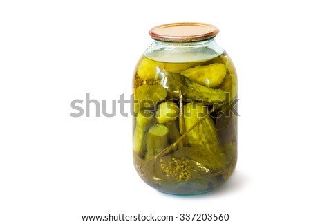 Home canning: a small glass cylinder with pickled cucumbers, sealed metal lid. Presented on a white background. - stock photo