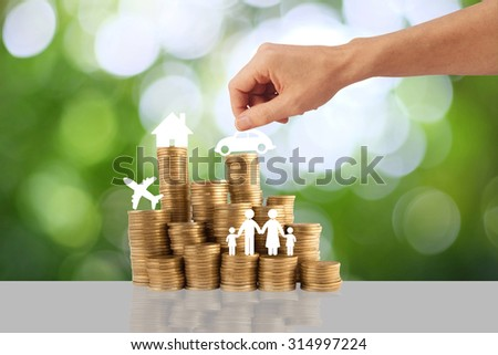 Home, car, family , travel and gold stack coins  on green background . The concept of purchase of habitation - stock photo