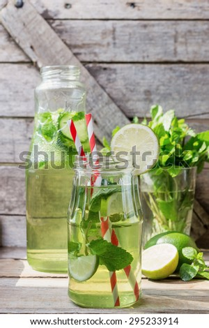 home chilled lemonade, lime, fresh cucumber and mint - stock photo