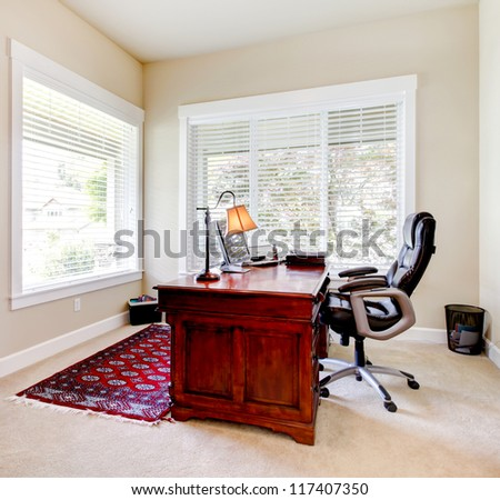 Home classic office with mahogany desk and leather chair. - stock photo