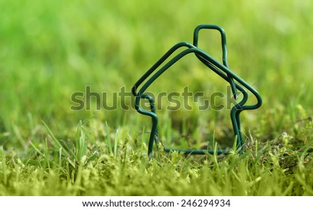 Home. clean energy and ecology conceptual photo. Shot outdoor in a green meadow. - stock photo