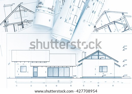 home construction plans and architectural blueprint rolls - stock photo