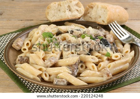 home cooked chicken and mushroom with pasta in a creamy mushroom sauce                               - stock photo