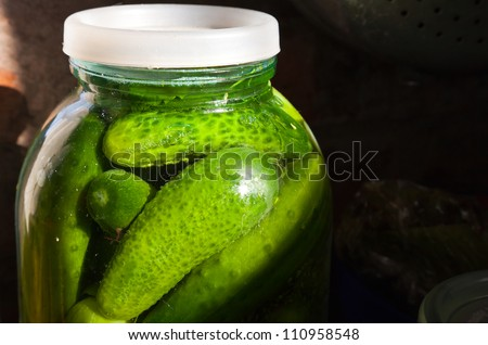 Home cooking object. Glass jar with fresh salted cucumbers - stock photo
