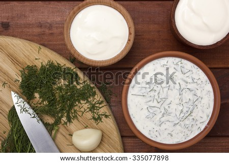 Home cooking - sauce, sour cream, garlic and dill. - stock photo