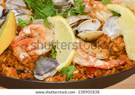 Home cooking the famous spanish mixed seafood paella / Spanish paella / Spanish food recipe - stock photo