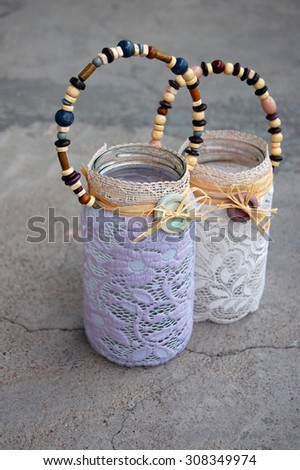 Home decor, candle holders with lace and buttons - stock photo