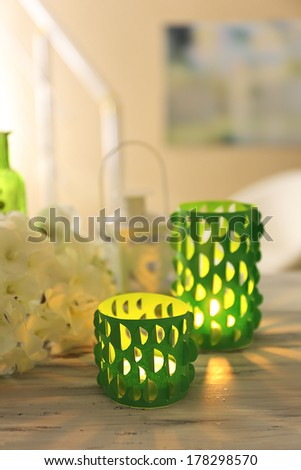 Home decor, candle lights on table - stock photo