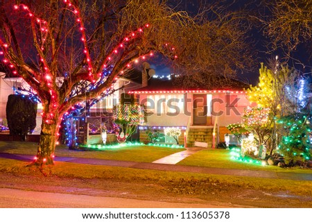 Home decorated and lighted for Christmas and for New Year Eve at Night in Vancouver, Canada.