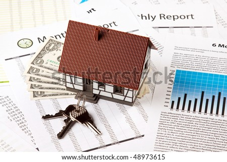 Home Expenses, keys and graphs - stock photo