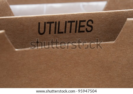 Home filing for utilities services bills and documents. - stock photo