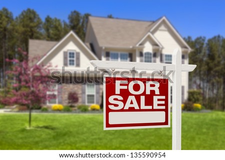 Home For Sale Real Estate Sign and Beautiful New House. - stock photo