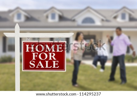 Home For Sale Real Estate Sign and Playful Hispanic Family in Front of House.