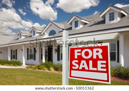 Home For Sale Real Estate Sign in Front of New House - Right Facing. - stock photo