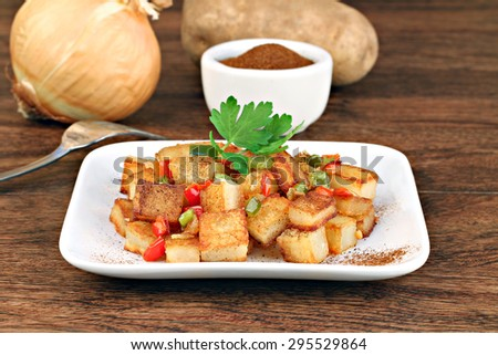 Home fried potatoes with peppers and onions. - stock photo