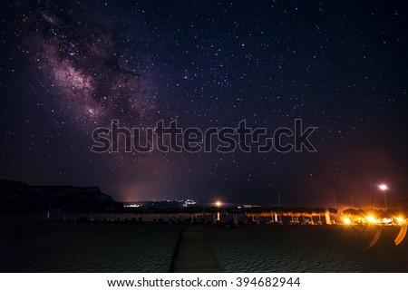 Home galaxy high above island Elafonisos, Greece. Long exposure shot at high iso/Milky Way - stock photo