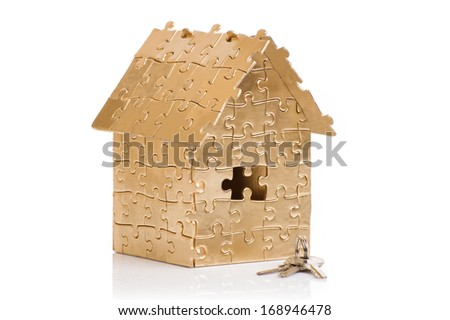 home gold color with a key on a white background - stock photo