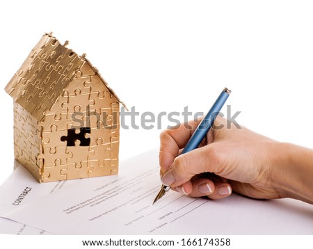 home gold color with the contract and pen on a white background - stock photo