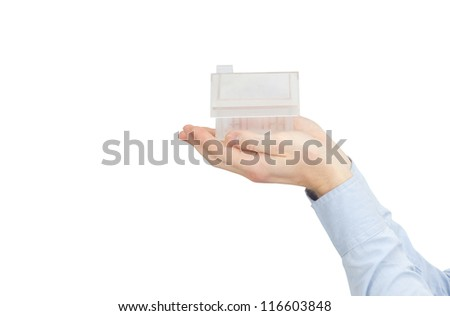 home in human hands on white - stock photo