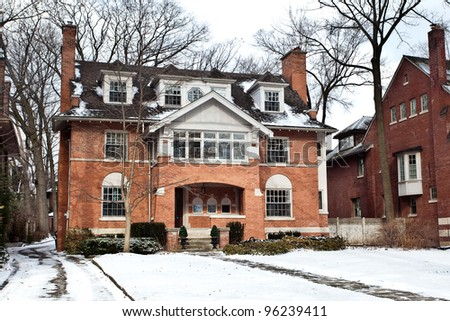 Home in winter with snow - stock photo