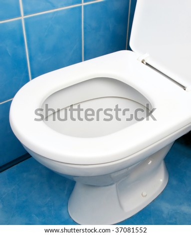 Home interior clean toilet sink bowl on tile floor - stock photo