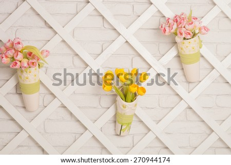 home interior decoration: a bouquet of tulips in a jug - stock photo
