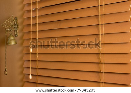 Home interior detail for drawn wooden blinds - stock photo
