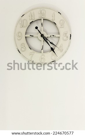 Home interior, white wall with vintage clock
