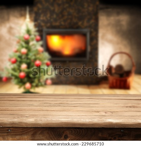home interior with background of table and fireplace with tree of green  - stock photo