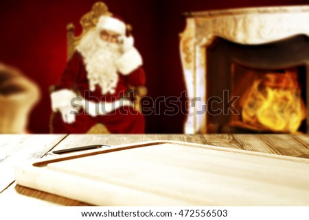 home interior with fireplace and santa claus on chair background with wooden table place
