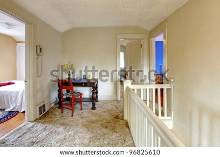 Home interior with old writing desk with red chair. - stock photo
