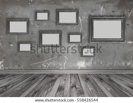Home interior with set of empty photo frames on grungy wall background. Copy space.
