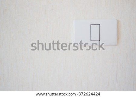 Home lighting switch on wall close up. - stock photo