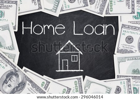 HOME LOAN text written on a blackboard with border made of 100 US dollars - stock photo