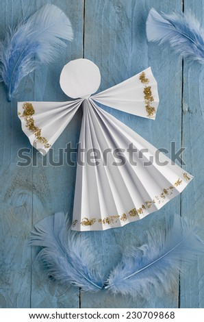home made angel on blue wooden background - stock photo