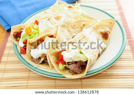 home made beef tacos with flank steak, salsa and greek yogurt - stock photo