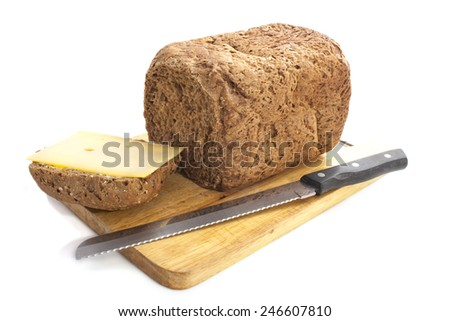 Home made bread on wooden plate isolated over white - stock photo
