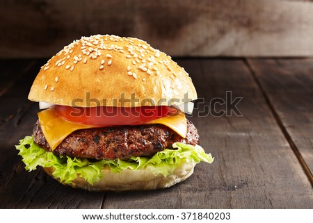 home made burger on a burned wooden background
