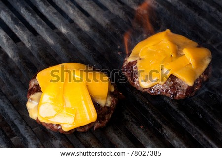 Home Made Cheeseburgers on Barbeque Grill - stock photo