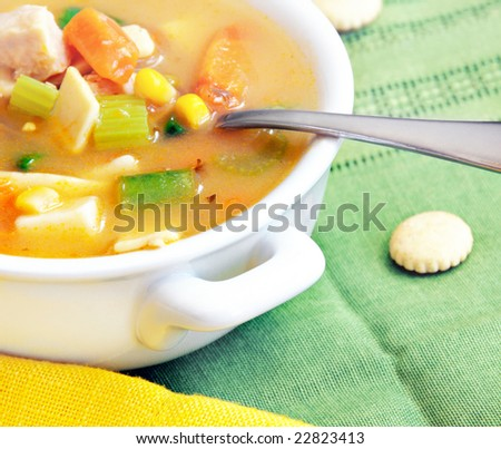 Home-made chicken and vegetable soup with oyster crackers.