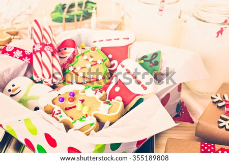 Home made Christmas cookies decorated with colorful icing. - stock photo