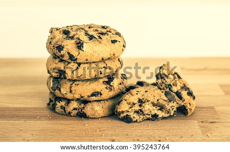 Home made cookies with chocolate on wood - stock photo