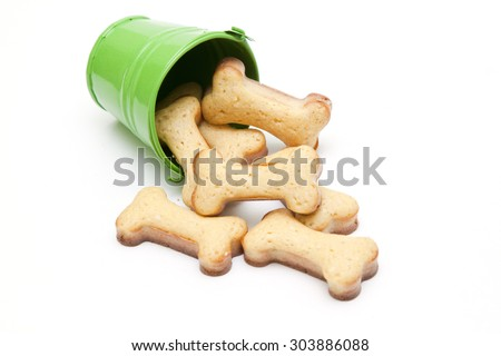 Home made dog biscuit in bucket Isolated on White Background - stock photo