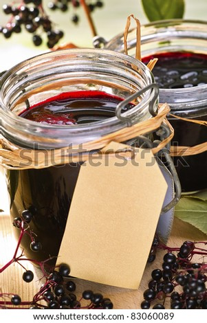 home-made elder jelly in glasses with fresh fruits