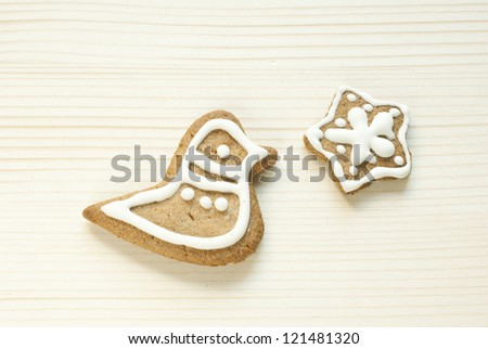 home made gingerbread cookies on wooden - stock photo