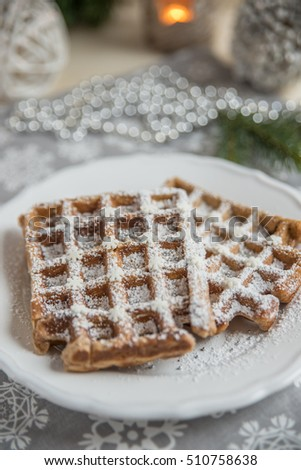home made gingerbread waffles on a plate
