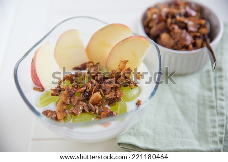 Home made granola with yoghurt, apple and grapes - stock photo